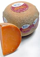 Edam-like, first requested by Louis XIV and famously aided in flavor by cheese mites: Mimolette