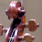 Ornate tailpiece and tuning pegs added in the 1850s.